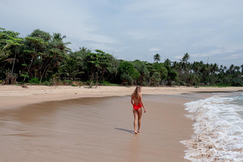 Charlotte walking on the beach at Talalla Beach