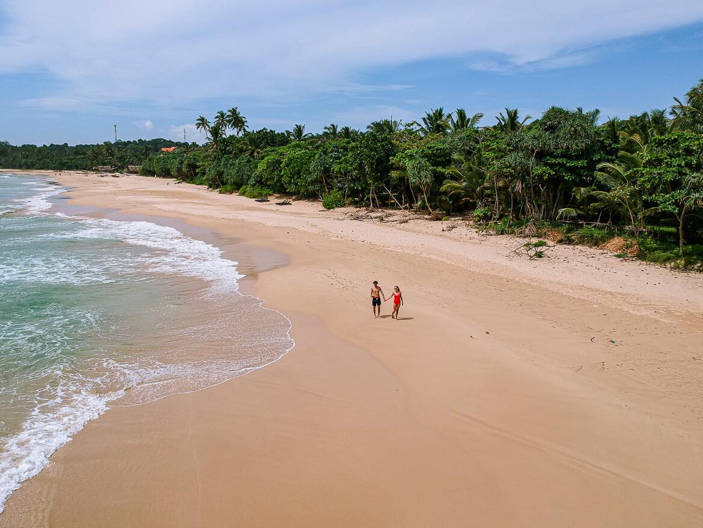 Talalla Beach Paradise walking couple